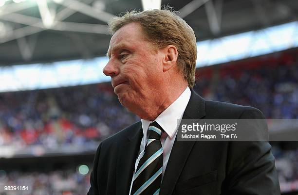 Tottenham Hotspur manager Harry Redknapp is dejected after defeat during the FA Cup sponsored by EON Semi Final match between Tottenham Hotspur and...