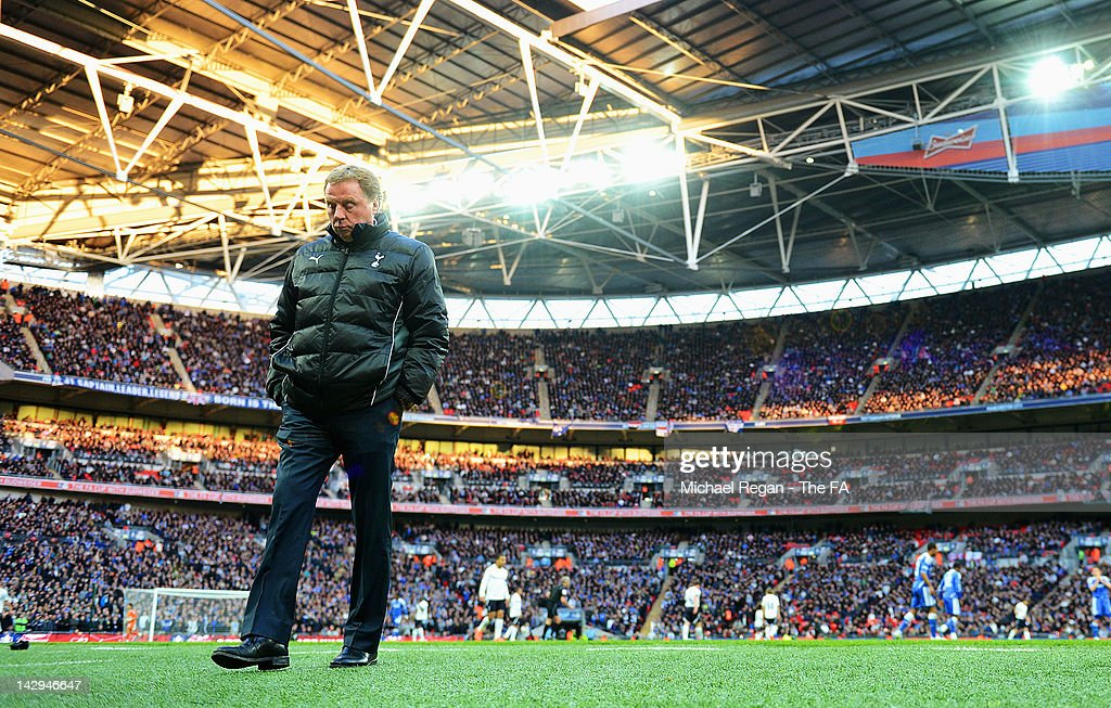 Tottenham Hotspur manager <a gi-track='captionPersonalityLinkClicked' href=/galleries/search?phrase=Harry+Redknapp&family=editorial&specificpeople=204768 ng-click='$event.stopPropagation()'>Harry Redknapp</a> looks dejected during the FA Cup with Budweiser Semi Final match between Tottenham Hotspur and Chelsea at Wembley Stadium on April 15, 2012 in London, England.