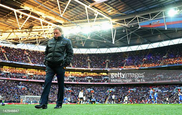 Tottenham Hotspur manager Harry Redknapp looks dejected during the FA Cup with Budweiser Semi Final match between Tottenham Hotspur and Chelsea at...