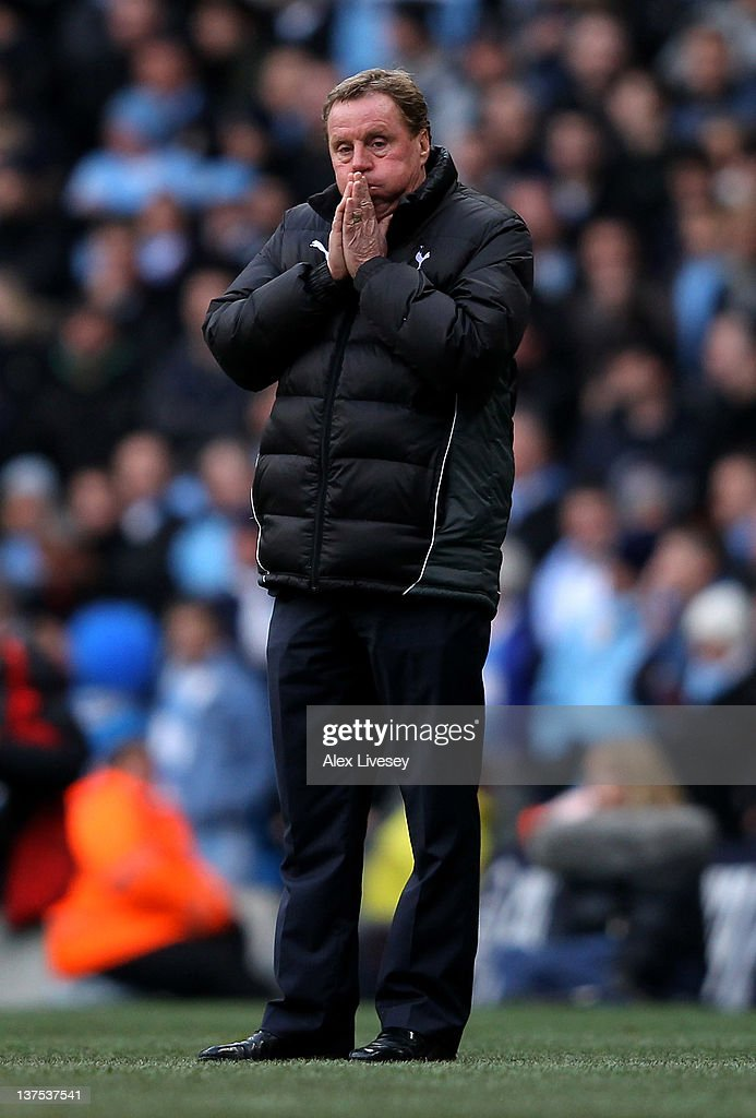 Tottenham Hotspur Manager <a gi-track='captionPersonalityLinkClicked' href=/galleries/search?phrase=Harry+Redknapp&family=editorial&specificpeople=204768 ng-click='$event.stopPropagation()'>Harry Redknapp</a> reacts during the Barclays Premier League match between Manchester City and Tottenham Hotspur at the Etihad Stadium on January 22, 2012 in Manchester, England.