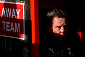 Tottenham Hotspur manager Harry Redknapp sits in the away dugout prior to the FA Cup Fifth Round match between Stevenage and Tottenham Hotspur at The...