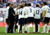 Tottenham Hotspur manager Harry Redknapp talks to his players during the FA Cup sponsored by EON Semi Final match between Tottenham Hotspur and...