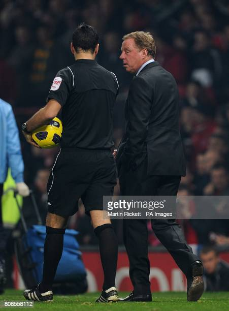 Tottenham Hotspur manager Harry Redknapp talks to referee Mark Clattenburg after the final whistle