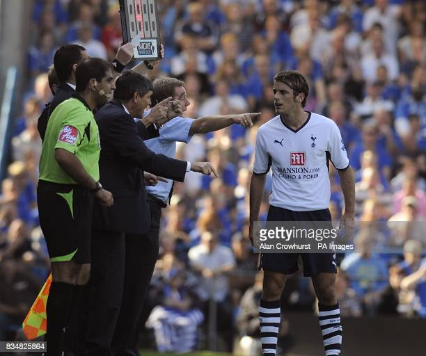 Tottenham Hotspur manager Juande Ramos and player David Bentley right along with portsmouth manager and Harry Redknapp on the touchline