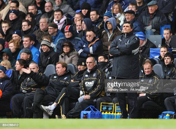 Tottenham Hotspur manager Juande Ramos and Portsmouth manager Harry Redknapp watch the action from the touchline
