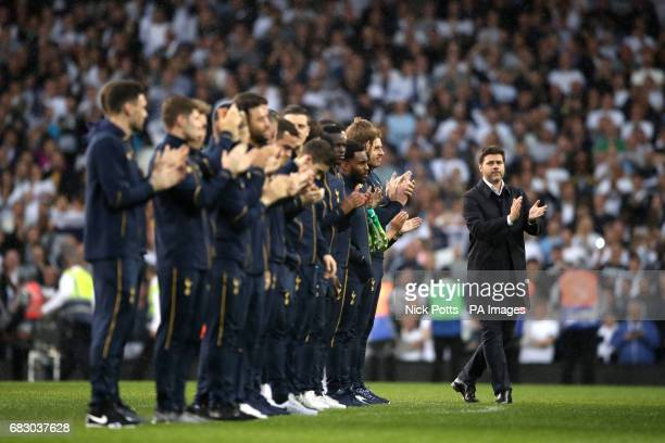 Tottenham Hotspur manager Mauricio Pochettino and his players applaud the former players as they ae announced on to the pitch after the Premier...