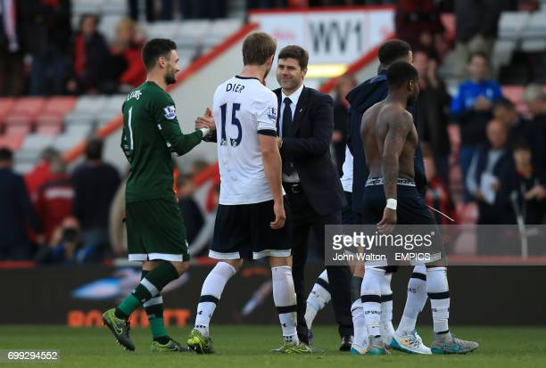 Tottenham Hotspur manager Mauricio Pochettino celebrates with Tottenham Hotspur goalkeeper Hugo Lloris and Tottenham Hotspur's Harry Kane at the end...