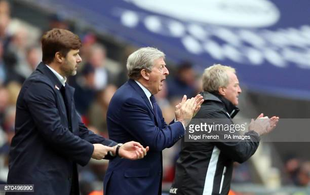 Tottenham Hotspur manager Mauricio Pochettino Crystal Palace manager Roy Hodgson and assistant Ray Lewington during the Premier League match at...