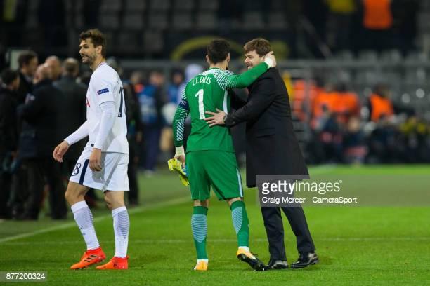 Tottenham Hotspur manager Mauricio Pochettino embraces Tottenham Hotspur's Hugo Lloris after the UEFA Champions League group H match between Borussia...