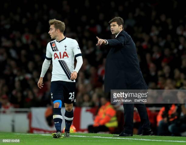Tottenham Hotspur manager Mauricio Pochettino gestures on the touchline as Tottenham Hotspur's Christian Eriksen looks on