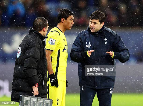 Tottenham Hotspur manager Mauricio Pochettino gives instruction to substitute Paulinho during the Barclays premier League match between Leicester...