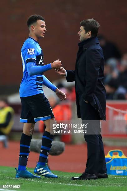 Tottenham Hotspur manager Mauricio Pochettino shakes the hand of Tottenham Hotspur's Dele Alli as he is subsituted