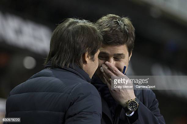 Tottenham Hotspur manager Mauricio Pochettino shares a joke with Chelsea manager Antonio Conte before the Premier League match between Tottenham...