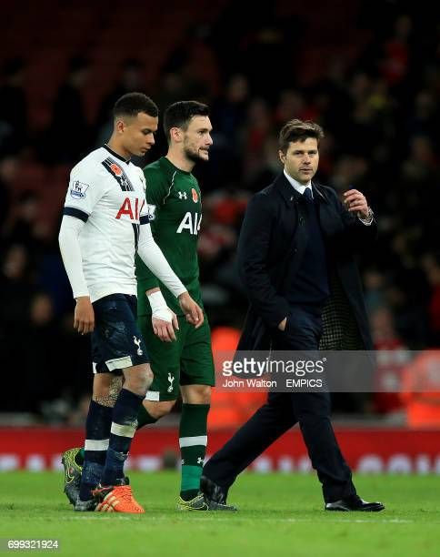 Tottenham Hotspur manager Mauricio Pochettino speaks with Tottenham Hotspur goalkeeper Hugo Lloris and Tottenham Hotspur's Dele Alli after the final...