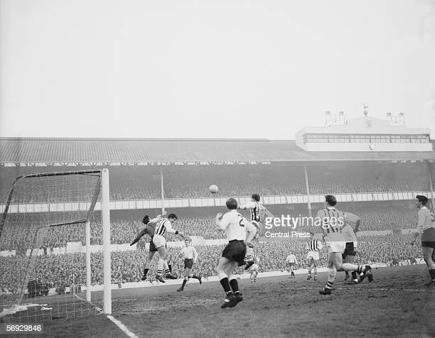 Tottenham Hotspur meet West Bromwich Albion at White Hart Lane 28th December 1963 Spurs goalie Brown dives for the ball with Jones Looking on are...