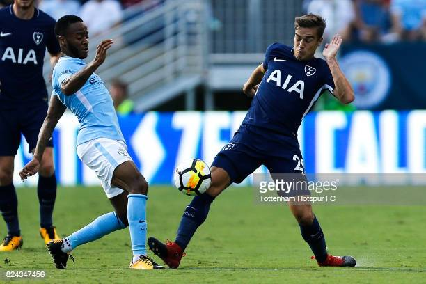 Tottenham Hotspur midfielder Harry Winks battles Manchester City forward Raheem Sterling during the International Champions Cup 2017 at Nissan...