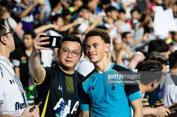 Tottenham Hotspur midfielder Luke Amos poses for selfie with fan during a Tottenham Hotspur training session at Hong Kong Stadium on May 25 2017 in...