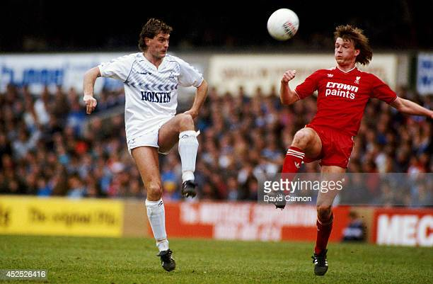Tottenham Hotspur player Glenn Hoddle challenges Nigel Spackman of Liverpool during a First Division match between Tottenham Hotspur and Liverpool at...