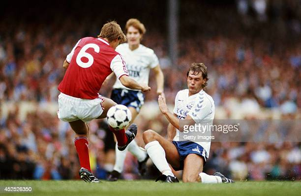 Tottenham Hotspur player Glenn Hoddle challenges Tony Adams of Arsenal during a First Division match between Arsenal and Tottenham Hotspur at...