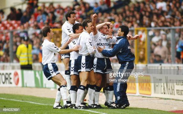 Tottenham Hotspur player Paul Gascoigne celebrates with team mates after his free kick goal during the FA Cup Semi Final between Tottenham Hotspur...