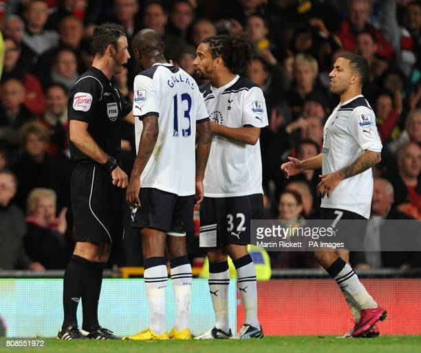 Tottenham Hotspur players argue with referee Mark Clattenburg about Manchester United's second goal