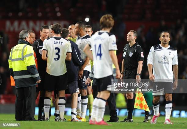Tottenham Hotspur players argue with referee Mark Clattenburg about Manchester United's second goal after the final whistle