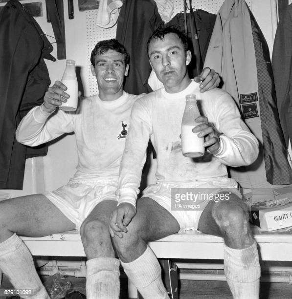 Tottenham Hotspur players Mike England and Jimmy Greaves celebrate Spurs' FA Cup Final 21 victory over Chelsea with a pint of milk after the game at...