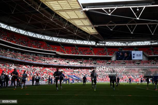 Tottenham Hotspur players warm up ahead of the English Premier League football match between Tottenham Hotspur and Chelsea at Wembley Stadium in...