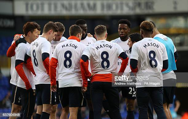 Tottenham Hotspur players wear tshirts in support of Ryan Mason during the warm up before the Emirates FA Cup fourth round match at White Hart Lane...