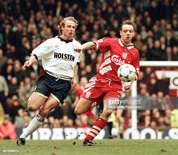 Tottenham Hotspur striker Jurgen Klinsmann challenges Liverpool defender Rob Jones during the FA Cup 6th round match at Anfield in Liverpool 11th...