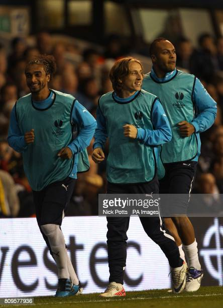 Tottenham Hotspur substitutes Benoit AssouEkotto Luka Modric and Younes Kaboul warm up on the touchline