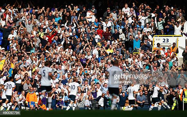 Tottenham Hotspur supporters celebrate their team's first goal by Eric Dier during the Barclays Premier League match between Tottenham Hotspur and...