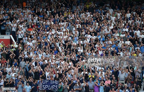 Tottenham Hotspur supporters in the crowd during the English Premier League football match between Manchester United and Tottenham Hotspur at Old...
