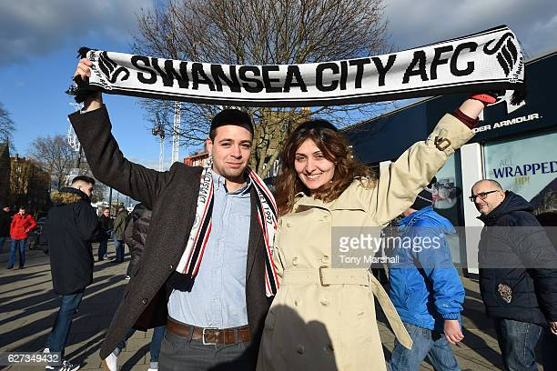 Tottenham Hotspur supporters pose for photographs prior to the Premier League match between Tottenham Hotspur and Swansea City at White Hart Lane on...