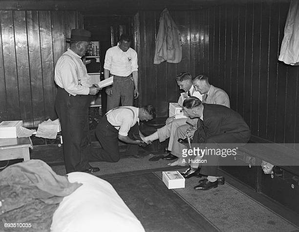 Tottenham Hotspur trainer George Hardy checking new running shoes being distributed to some of the players at Spurs' White Hart Lane ground London...