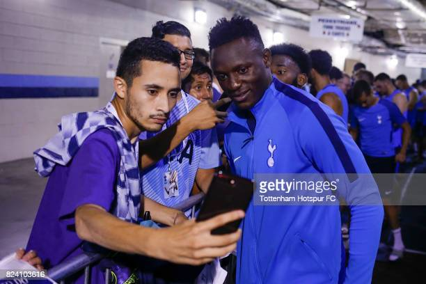 Tottenham Hotspur Victor Wanyama poses for a photo with a fan following the Tottenham Hotspur training session at Nissan Stadium on July 28 2017 in...