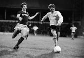Tottenham Hotspur winger Alistair Dick is challenged by Everton defender Gary Stevens during their Division One league match held at White Hart Lane...