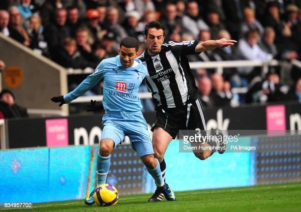 Tottenham Hotspur's Aaron Lennon and Newcastle United's Sanchez Jose Enrique battle for the ball
