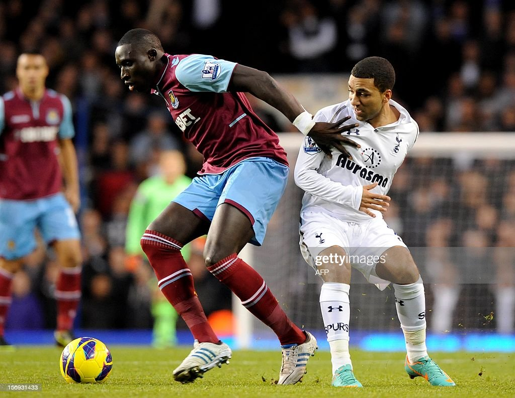 """Tottenham Hotspur's aaron Lennon (R) vies with West Ham's Modibo Maiga during their Barclays Premier League football match White Hart Lane in North London, England on 25 November, 2012. AFP PHOTO/Olly Greenwood USE. No use with unauthorized audio, video, data, fixture lists, club/league logos or """"live"""" services. Online in-match use limited to 45 images, no video emulation. No use in betting, games or single club/league/player publications."""