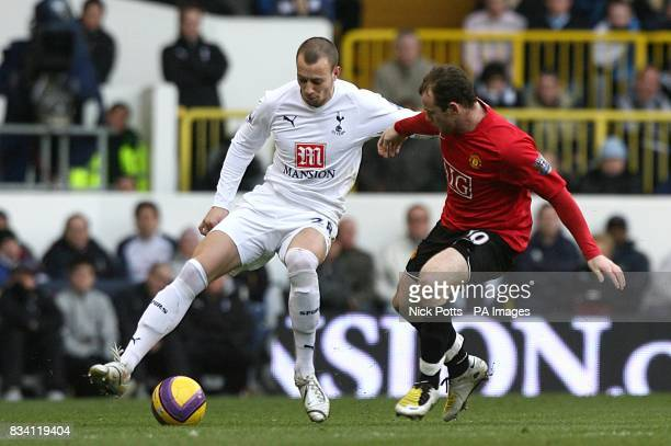 Tottenham Hotspur's Alan Hutton and Manchester United's Wayne Rooney battle for the ball