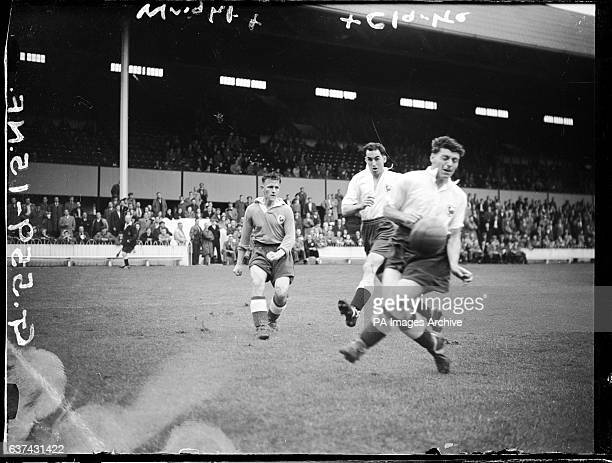 Tottenham Hotspur's Alex Wright passes the ball past clubmate Harry Clarke during a preseason practice match