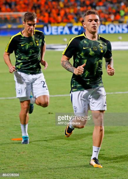 Tottenham Hotspur's Argentine defender Juan Foyth and English defender Kieran Trippier warmup ahead of the UEFA Champions League football match...