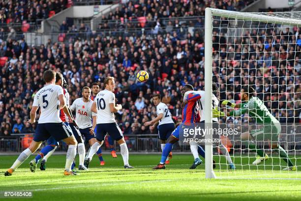 Tottenham Hotspur's Argentinian goalkeeper Paulo Gazzaniga dives to save a header by Crystal Palace's English defender Scott Dann during the English...