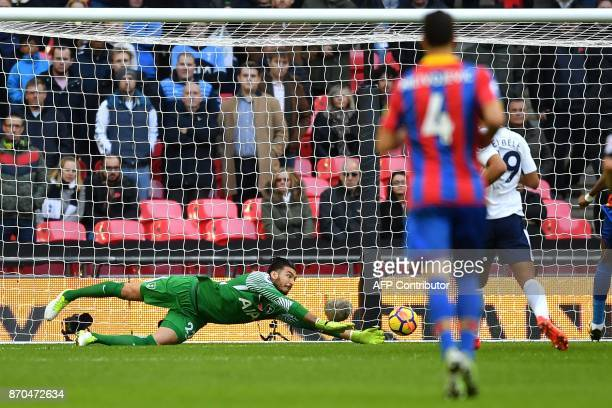 Tottenham Hotspur's Argentinian goalkeeper Paulo Gazzaniga dives to save a shot from Crystal Palace's English midfielder Andros Townsend during the...