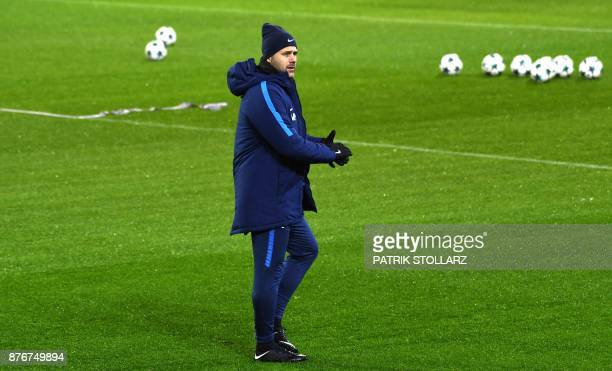 Tottenham Hotspur's Argentinian head coach Mauricio Pochettino oversees a training session on the eve of the UEFA Champions League Group H football...
