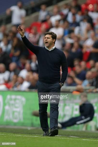 Tottenham Hotspur's Argentinian head coach Mauricio Pochettino gestures during the English Premier League football match between Tottenham Hotspur...