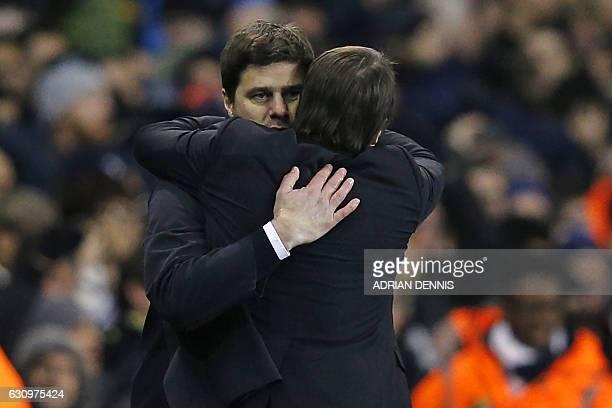 Tottenham Hotspur's Argentinian head coach Mauricio Pochettino embraces Chelsea's Italian head coach Antonio Conte after the English Premier League...