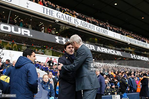 Tottenham Hotspur's Argentinian head coach Mauricio Pochettino shakes hands with Arsenal's French manager Arsene Wenger ahead of the English Premier...