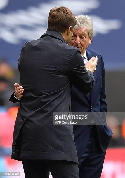 Tottenham Hotspur's Argentinian head coach Mauricio Pochettino shakes hands with Crystal Palace's English manager Roy Hodgson following the English...