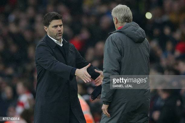 Tottenham Hotspur's Argentinian head coach Mauricio Pochettino shakes hands with Arsenal's French manager Arsene Wenger following the English Premier...